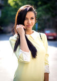 Fashion woman with the sun in the back. Royalty Free Stock Photos