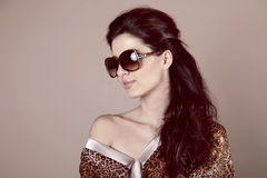 Fashion Woman in sun glasses over beige Stock Photos