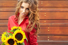 Fashion woman with sunflower Stock Images