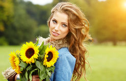 Fashion woman with sunflower Stock Photography