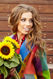 Fashion woman with sunflower Stock Photo
