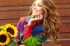 Fashion woman with sunflower Royalty Free Stock Image