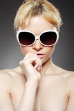 Fashion woman with sunglasses. On gray background Stock Images