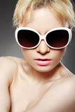 Fashion woman with sunglasses. On gray background Royalty Free Stock Images
