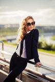 Fashion woman in sunglasses on the city street Royalty Free Stock Images