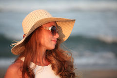 Fashion woman with sunglasses and hat on sunny day at sea Royalty Free Stock Image