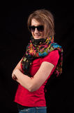 Fashion woman with sunglasses and scarf posing on black backgrou Royalty Free Stock Photography