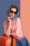 Fashion woman in sunglasses and scarf. Stock Photo