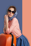 Fashion woman in sunglasses and scarf. Studio shot Stock Photos