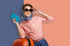 Fashion woman in sunglasses and scarf. Studio shot Royalty Free Stock Photos