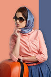 Fashion woman in sunglasses and scarf. Studio shot Royalty Free Stock Photography
