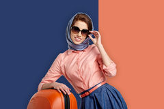 Fashion woman in sunglasses and scarf. Royalty Free Stock Images