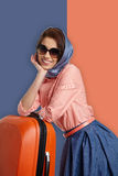 Fashion woman in sunglasses and scarf. Studio shot Royalty Free Stock Images