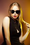 Fashion woman in sunglasses, studio shot. Professional makeup. Close-up portrait of beautiful and fashion woman in sunglasses, studio shot. Professional makeup Royalty Free Stock Photo