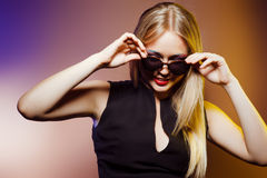 Fashion woman in sunglasses, studio shot. Professional makeup. Close-up portrait of beautiful and fashion woman in sunglasses, studio shot. Professional makeup Royalty Free Stock Photography