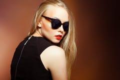 Fashion woman in sunglasses, studio shot. Professional makeup an. Close-up portrait of beautiful and fashion woman in sunglasses, studio shot. Professional Stock Photos