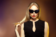 Fashion woman in sunglasses, studio shot. Professional makeup an Royalty Free Stock Photo