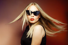 Fashion woman in sunglasses, studio shot. Professional makeup an. Close-up portrait of beautiful and fashion woman in sunglasses, studio shot. Professional Royalty Free Stock Images