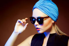 Fashion woman in sunglasses, studio shot. Professional makeup an. Close-up portrait of beautiful and fashion woman in sunglasses, studio shot. Professional Royalty Free Stock Photos