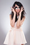 Fashion woman takes off glasses Royalty Free Stock Images