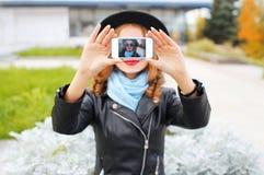 Fashion woman taking photo self portrait on smartphone in city closeup. Screen Stock Photos