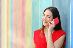 Fashion woman talking on phone in a colorful street royalty free stock images