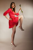 Fashion woman teen girl in red gown with dry rose. Stock Images