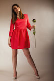 Fashion woman teen girl in red gown with dry rose. Stock Photo