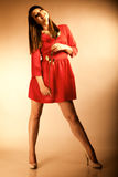 Fashion woman teen girl in red gown with dry rose. Royalty Free Stock Photo