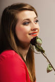 Fashion woman teen girl in red gown with dry rose. Royalty Free Stock Photography
