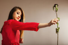 Fashion woman teen girl in red gown with dry rose. Stock Photography