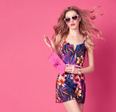Fashion woman in Trendy Spring Summer Flower Dress. Fashion woman in Trendy Spring Summer Dress. Stylish wavy hairstyle, fashion Sunglasses, Summer Floral Outfit Royalty Free Stock Photography