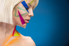 Fashion woman with triangles on the face Royalty Free Stock Photos
