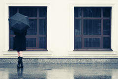 Fashion woman with umbrella in the rain Royalty Free Stock Photo