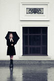 Fashion woman with umbrella in the rain Royalty Free Stock Photography