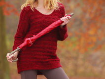 Fashion woman with umbrella relaxing in fall park. Stock Image