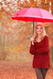 Fashion woman with umbrella relaxing in fall park. Stock Images