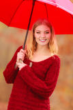 Fashion woman with umbrella relaxing in fall park. Royalty Free Stock Photo