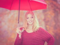 Fashion woman with umbrella relaxing in fall park. Stock Photos