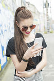 Fashion woman using phone. Royalty Free Stock Photography