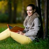 Fashion woman using a tablet computer outside in Royalty Free Stock Photo