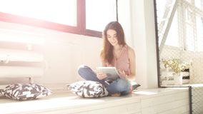 Fashion woman using tablet. With sunbeams and lens flare stock video footage