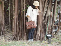 Fashion woman with vintage leather bag Stock Images