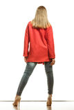Fashion woman in vivid color red coat rear view Stock Images