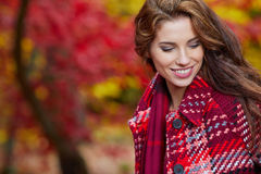 Fashion woman walking in autumn park Royalty Free Stock Photography