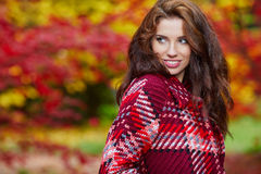 Fashion woman walking in autumn park Stock Photography