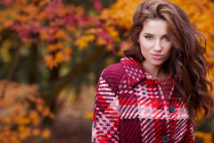 Fashion woman walking in autumn park Stock Photo