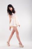 Fashion woman walking pose Royalty Free Stock Photography