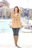 Fashion woman walking and using smart phone Stock Images