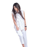 Fashion woman wear white pants and shirt isolated over white Royalty Free Stock Photos